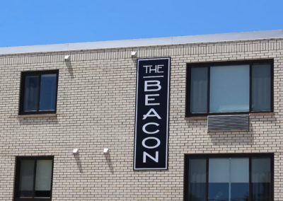 The Beacon Front Sign Straight Close-up