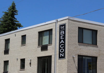 The Beacon Front Sign Close-up