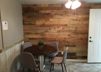 The Parker den area entrance and barn board wall.